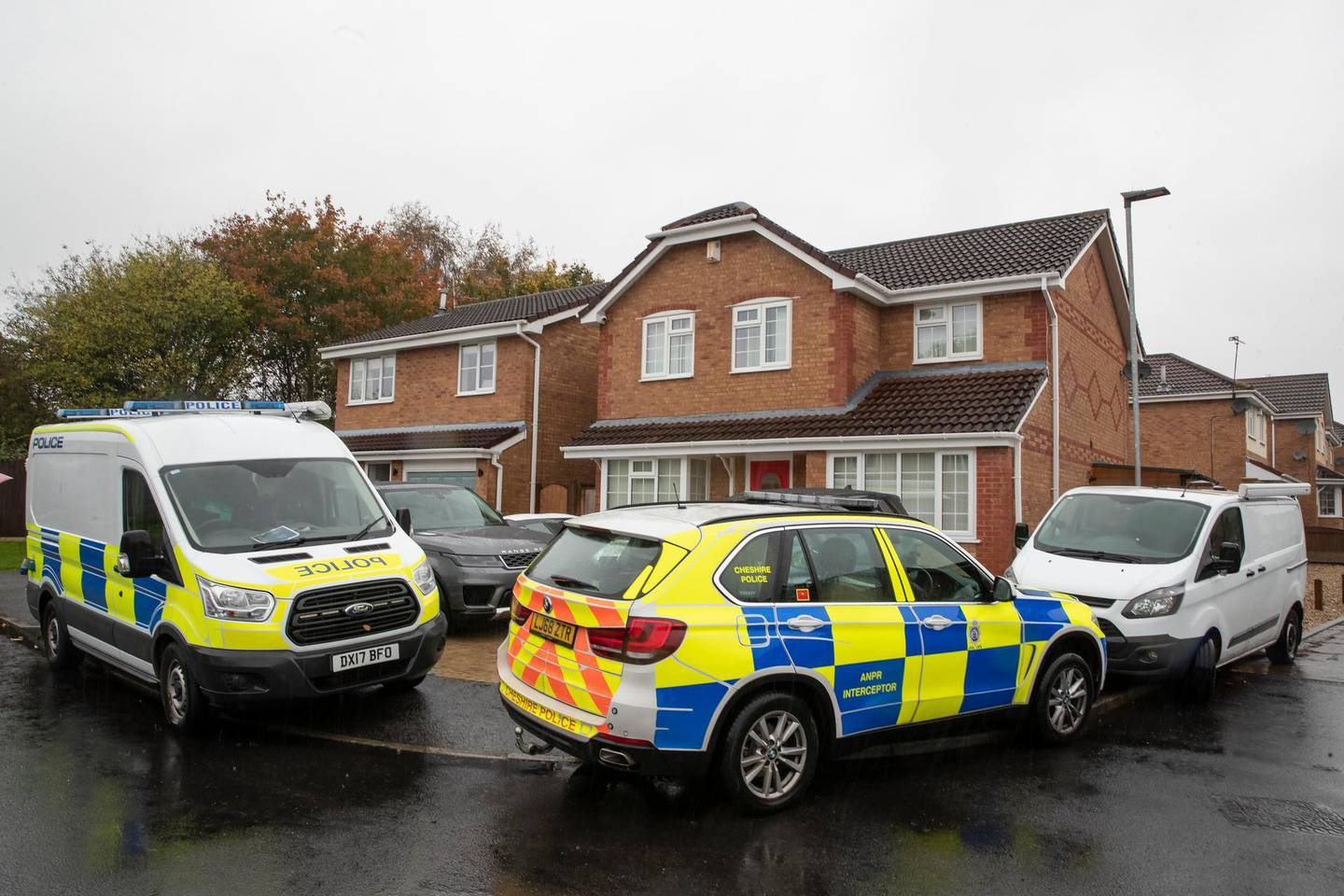 Police outside the house of Joanna and Thomas Maher in Warrington, who have said they had sold the Scania lorry cab, which is registered in Bulgaria, to a company in Ireland, after 39 migrants were found dead in a refrigerated trailer in Grays in the early hours of Wednesday.