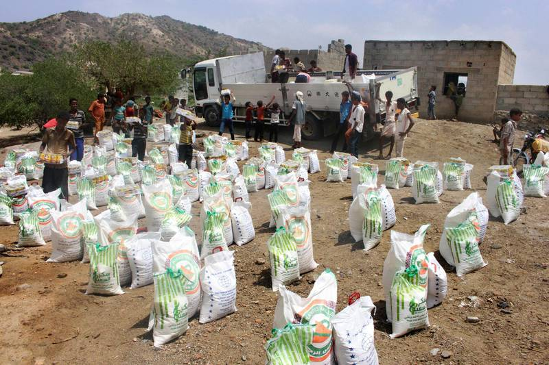 In this Sept. 23, 2018 file photo, men deliver aid donations from donors, in Aslam, Hajjah, Yemen. Houthi rebels in Yemen have blocked half of the United Nations' aid delivery programs in the war-torn country — a strong-arm tactic to force the agency to give them greater control over the massive humanitarian campaign, along with a cut of billions of dollars in foreign assistance, according to aid officials and internal documents obtained by The Associated Press. (AP Photo/Hammadi Issa, File)