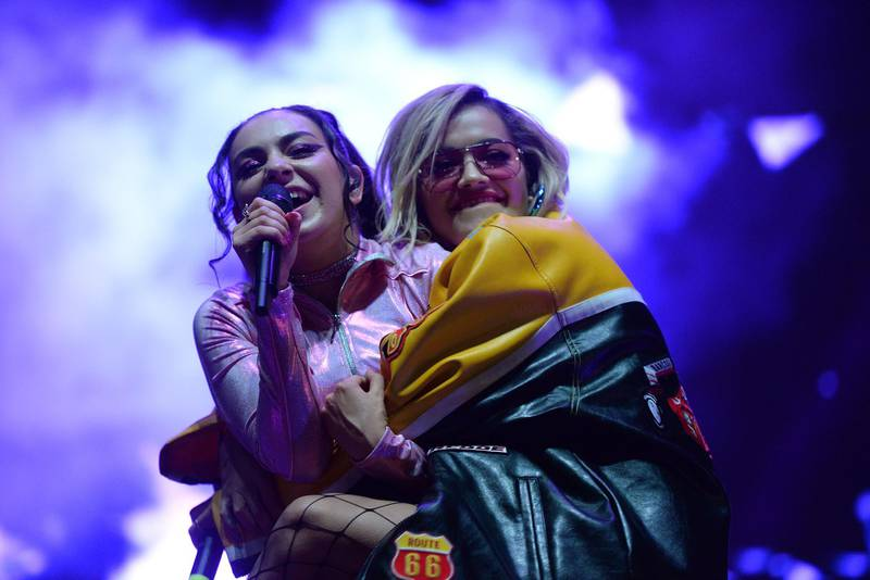 WEST HOLLYWOOD, CA - JUNE 11:  Singers Charli XCX (L) and Rita Ora (R) perform onstage during LA Pride Festival on June 10, 2016 in West Hollywood, California.  (Photo by Scott Dudelson/Getty Images)