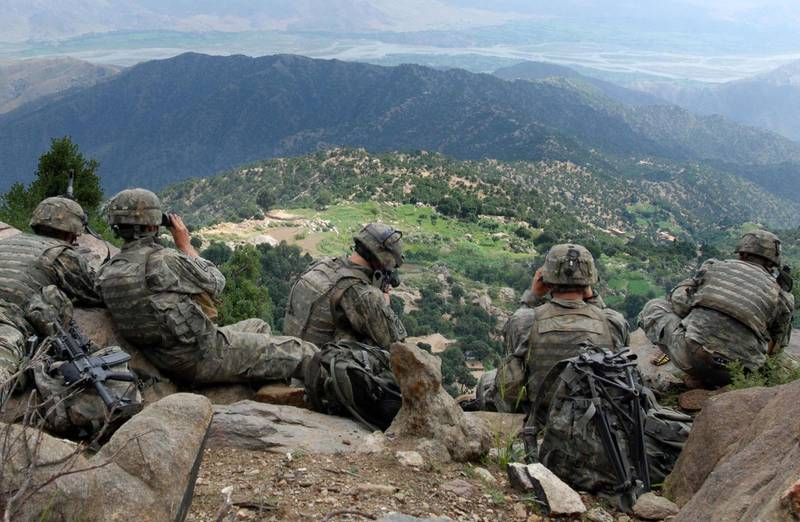 070822-A-6849A-667 -- Scouts from 2nd Battalion, 503rd Infantry Regiment (Airborne), pull overwatch during Operation Destined Strike while 2nd Platoon, Able Company searches a village below the Chowkay Valley in Kunar Province, Afghanistan Aug. 22 2006 US Army