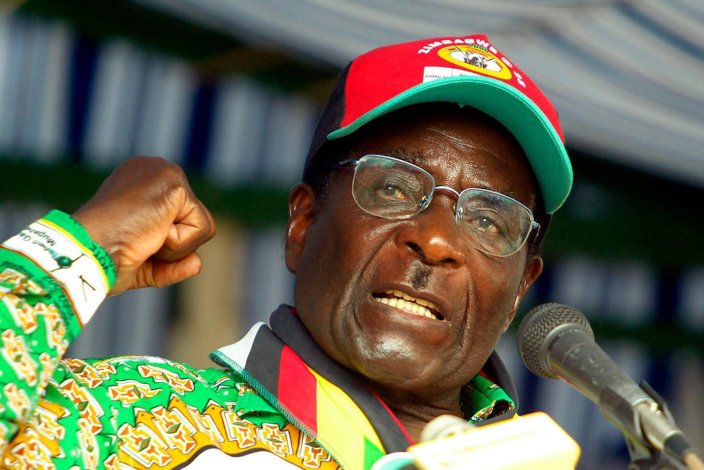 epa07821744 (FILE) - Zimbabwean President Robert Mugabe expresses himself during a ZANU-PF rally near the town of Mbaira south of Harare, Zimbabwe, Friday, 25 March 2005 (issued 06 September 2019). According to media reports, Robert Mugabe died on 06 September 2019 at the age of 95, in a Singapore hospital. Robert Mugabe became prime minister of Zimbabwe (formerly known as Rhodesia) in 1980 and served as the country's president from 1987 until his forced resignation in 2017, after 37 years of autocratic rule. In 1963, he co-founded ZANU, a resistance movement against British colonial rule.  EPA/STR
