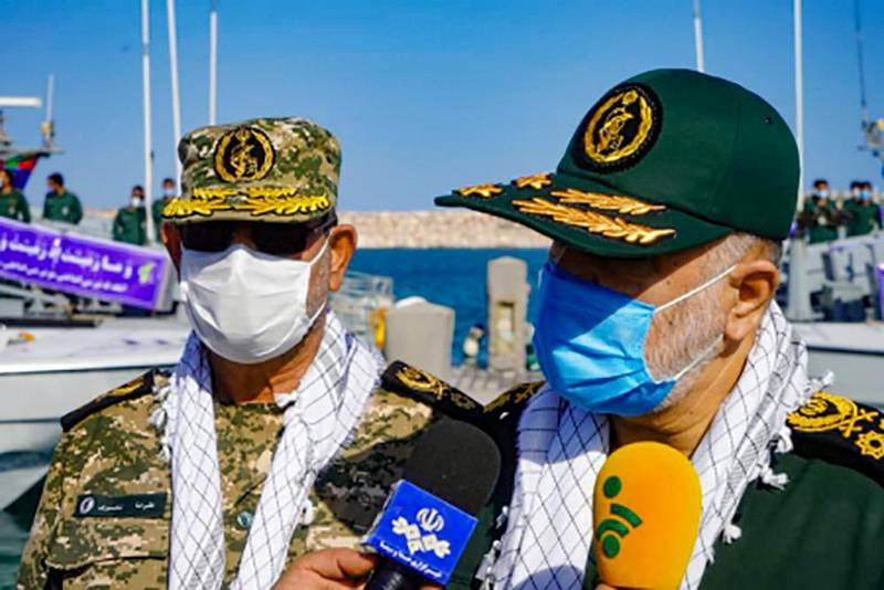 """This handout photo provided by Iran's Revolutionary Guard Corps (IRGC) official website via SEPAH News on January 2, 2021, shows Guards' chief Major General Hossein Salami (R), accompanied by Islamic Revolutionary Guard Corps navy commander Rear Admiral Alireza Tangsiri, speaking to journalists during his visit to the island of Abu Musa, off the coast of the southern Iranian city of Bandar Lengeh facing the United Arab Emirates.  Salami vowed today to respond to any """"action the enemy takes"""" in a visit to the strategic island in the Gulf, amid rising tensions with the US,  speaking on the eve of the first anniversary of the US killing of top Iranian military commander Qasem Soleimani in a Baghdad drone strike on January 3, 2020 - XGTY / RESTRICTED TO EDITORIAL USE - MANDATORY CREDIT """"AFP PHOTO / Iran's Revolutionary Guard via SEPAH NEWS"""" - NO MARKETING - NO ADVERTISING CAMPAIGNS - DISTRIBUTED AS A SERVICE TO CLIENTS   / AFP / SEPAH NEWS / - / XGTY / RESTRICTED TO EDITORIAL USE - MANDATORY CREDIT """"AFP PHOTO / Iran's Revolutionary Guard via SEPAH NEWS"""" - NO MARKETING - NO ADVERTISING CAMPAIGNS - DISTRIBUTED AS A SERVICE TO CLIENTS"""