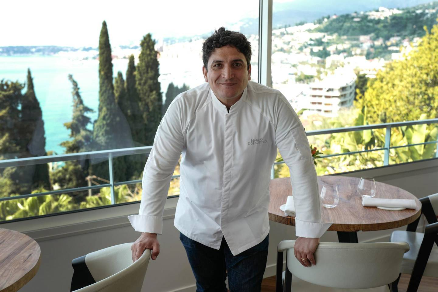 """(FILES) In this file photo taken on April 13, 2019 Italian-Argentinian chef Mauro Colagreco poses in his """"Mirazur"""" restaurant on the French riviera city of Menton after being awarded with a third star in the Guide Michelin. Colagreco was elected """"best chief of the year"""" by his French pairs on September 23, 2019. / AFP / VALERY HACHE"""