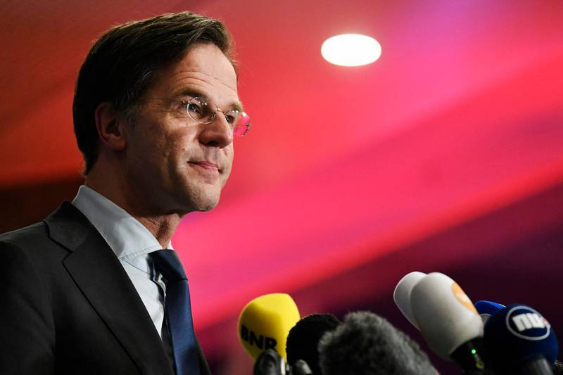 Outgoing Dutch Prime Minister Mark Rutte reacts to the exit pools of the House of Representatives' elections in the Hague, on March 17, 2021. Dutch Prime Minister Mark Rutte's party won the most seats in elections dominated by the coronavirus pandemic, putting him on course to lead his fourth coalition, exit polls said on March 17, 2021. / AFP / POOL / PIROSCHKA VAN DE WOUW