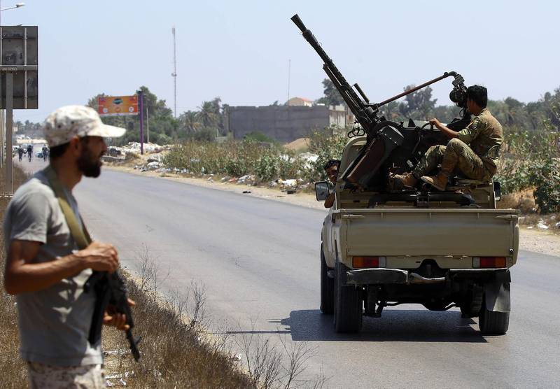 Libyans security forces patrol on August 23, 2018 near the site of an attack on a checkpoint in the city of Zliten, 170 km east of the capital Tripoli. - An attack on a checkpoint between the Libyan capital and the town of Zliten killed four soldiers of the UN-backed unity government on today, the town's mayor said. (Photo by Mahmud TURKIA / AFP)