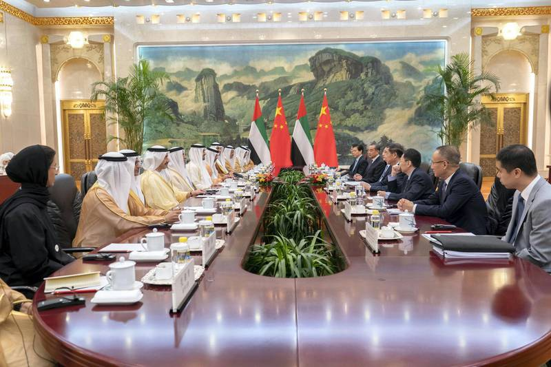 BEIJING, CHINA - July 22, 2018: HH Sheikh Mohamed bin Zayed Al Nahyan, Crown Prince of Abu Dhabi and Deputy Supreme Commander of the UAE Armed Forces (6th L), meets with HE Li Keqiang, Premier of the State Council of China (5th L), at the Great Hall of the People. Seen with HE Noura Mohamed Al Kaabi, UAE Minister of Culture and Knowledge Development (L), HE Ali Mohamed Hammad Al Shamsi, Deputy Secretary-General of the UAE Supreme National Security Council (3rd L), HH Sheikh Abdullah bin Zayed Al Nahyan, UAE Minister of Foreign Affairs and International Cooperation (5th L), HH Lt General Sheikh Saif bin Zayed Al Nahyan, UAE Deputy Prime Minister and Minister of Interior (6th L), HH Sheikh Hamed bin Zayed Al Nahyan, Chairman of the Crown Prince Court of Abu Dhabi and Abu Dhabi Executive Council Member (7th L), HE Khaldoon Khalifa Al Mubarak, CEO and Managing Director Mubadala, Chairman of the Abu Dhabi Executive Affairs Authority and Abu Dhabi Executive Council Member (8th L), HE Sultan bin Saeed Al Mansouri, UAE Minister of Economy (9th L) and HE Dr Sultan Ahmed Al Jaber, UAE Minister of State, Chairman of Masdar and CEO of ADNOC Group (10th L).  ( Rashed Al Mansoori / Ministry of Presidential Affairs ) ---