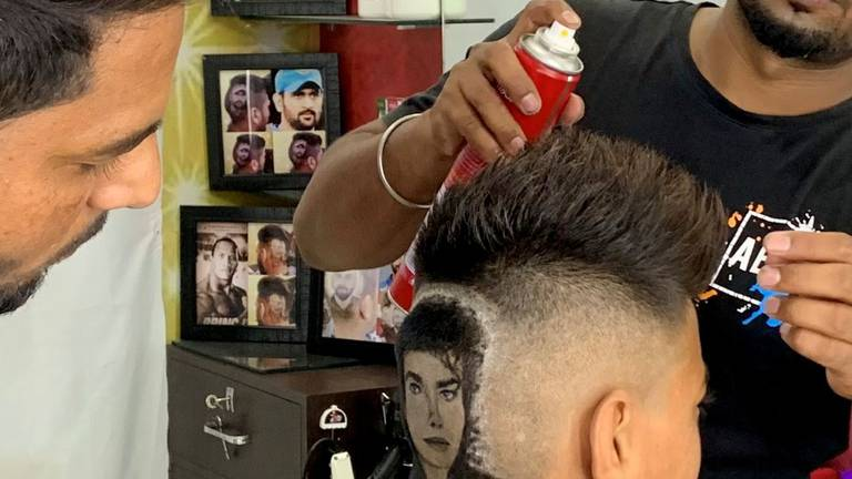 An image that illustrates this article Indian barber brothers turn heads with intricately shaved hair designs