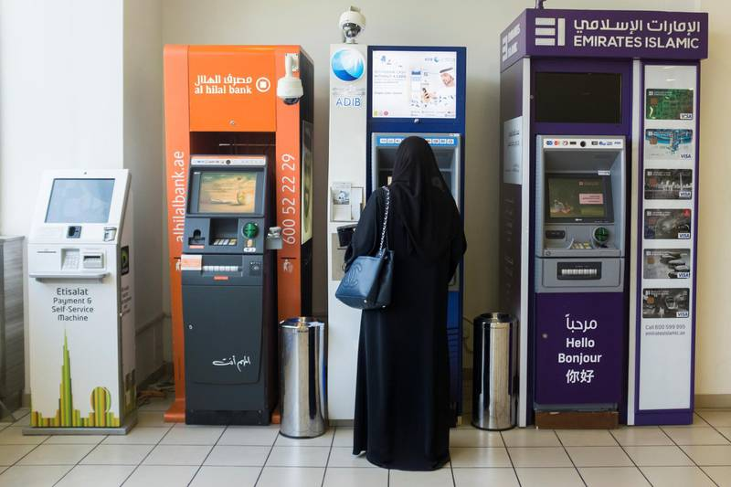 DUBAI, UNITED ARAB EMIRATES - JUNE 18, 2018.   A woman withdraws money from ADIB's atm.  (Photo by Reem Mohammed/The National)  Reporter:  Section: NA STANDALONE