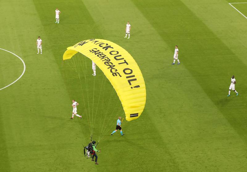 Soccer Football - Euro 2020 - Group F - France v Germany - Football Arena Munich, Munich, Germany - June 15, 2021 A Greenpeace protestor glides on to the pitch before the match Pool via REUTERS/Alexander Hassenstein     TPX IMAGES OF THE DAY