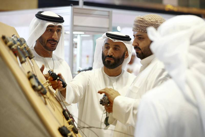 ABU DHABI ,  UNITED ARAB EMIRATES , AUGUST 27 – 2019 :- Visitors looking guns at one of the stand during the ADIHEX 2019 held at ADNEC in Abu Dhabi. ( Pawan Singh / The National ) For News/Online/Instagram/Big Picture. Story by Daniel
