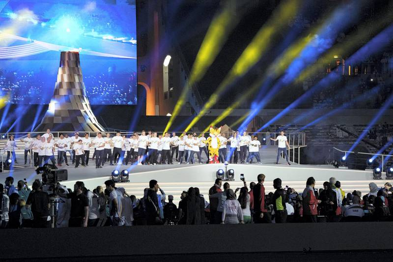 ABU DHABI, UNITED ARAB EMIRATES - March 21, 2019: Performers participate in a show during the closing ceremony of the Special Olympics World Games Abu Dhabi 2019, at Zayed Sports City.   ( Hamad Al Mansoori for Ministry of Presidential Affairs ) ---