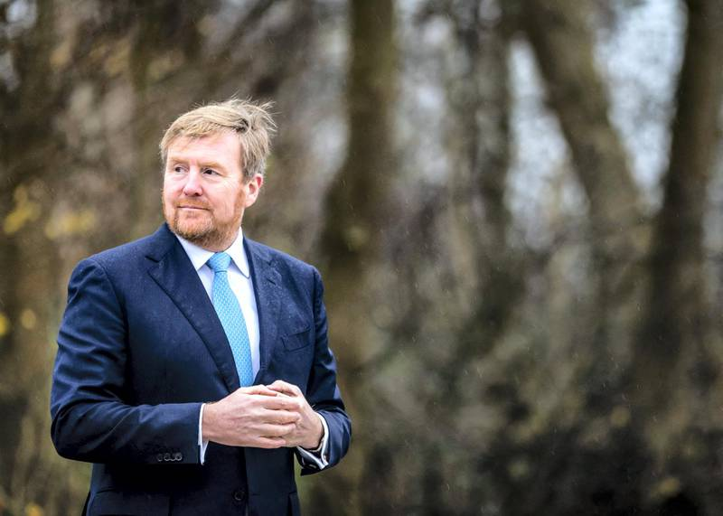 Dutch King Willem-Alexander (R) visits the Willem III Rowing Club to work on covid-19 health measures impacts in sport, in Amsterdam, on December 11, 2020. (Photo by Remko de Waal / ANP / AFP) / Netherlands OUT