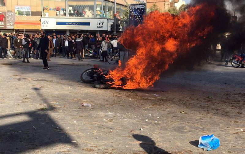 epa08002203 Iranian protesters clash in the streets following fuel price increase in the city of Isfahan, central Iran, 16 November 2019. Media reported that people protests in highways and in the streets after the government increased fuel price. Due to the ongoing economic crisis, the Iranian government has increased fuel prices up to 50 percent and the petrol price has become three times higher.  EPA/STR