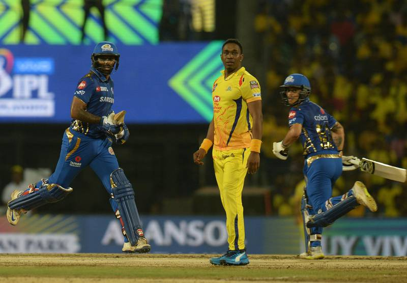 Mumbai Indians cricketer Surya Kumar Yadav (L) and Ishan Kishan (R) run between wickets as Chennai Super Kings Cricketer Dwayne Bravo (C) gestures during the 2019 Indian Premier League (IPL) first Qualifier Twenty20 cricket match between Chennai Super Kings and Mumbai Indians at the MA Chidambaram stadium in Chennai on May 7, 2019. (Photo by ARUN SANKAR / AFP) / IMAGE RESTRICTED TO EDITORIAL USE - STRICTLY NO COMMERCIAL USE