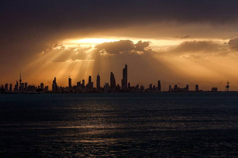 This picture taken on May 2, 2021 shows a view of the Kuwait City skyline at sunset.  / AFP / YASSER AL-ZAYYAT