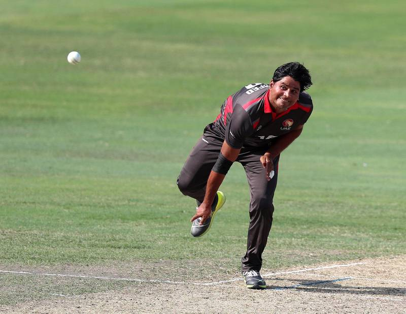 Dubai, United Arab Emirates - October 30, 2019: Waheed Ahmed of the UAE bowls during the game between the UAE and Scotland in the World Cup Qualifier in the Dubai International Cricket Stadium. Wednesday the 30th of October 2019. Sports City, Dubai. Chris Whiteoak / The National
