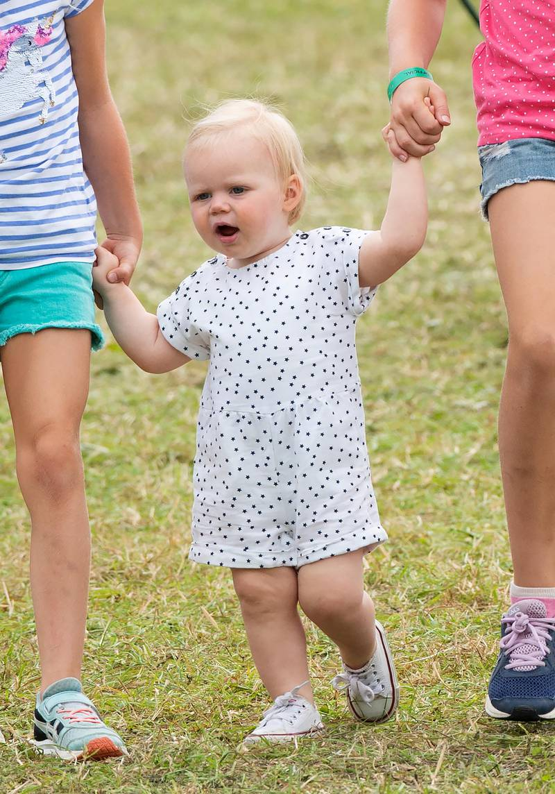 Toddler Lena Tindall walks with her cousins Savannah Phillips and Isla Phillips during the Festival of British Eventing at Gatcombe Park on August 04, 2019.