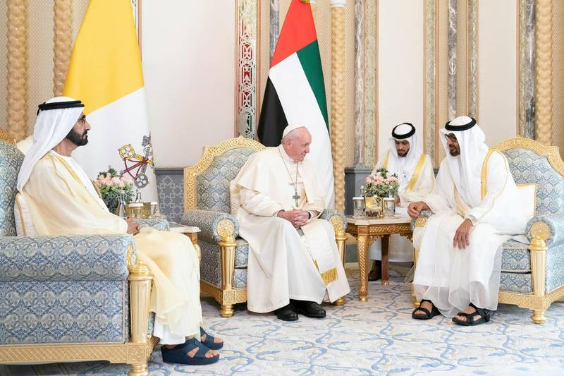 ABU DHABI, UNITED ARAB EMIRATES - February 4, 2019: Day two of the UAE Papal visit - HH Sheikh Mohamed bin Rashid Al Maktoum, Vice-President, Prime Minister of the UAE, Ruler of Dubai and Minister of Defence (L), and HH Sheikh Mohamed bin Zayed Al Nahyan, Crown Prince of Abu Dhabi and Deputy Supreme Commander of the UAE Armed Forces (R), meet with His Holiness Pope Francis, Head of the Catholic Church (C), during an official reception at the Presidential Palace.  ( Ryan Carter / Ministry of Presidential Affairs ) ---