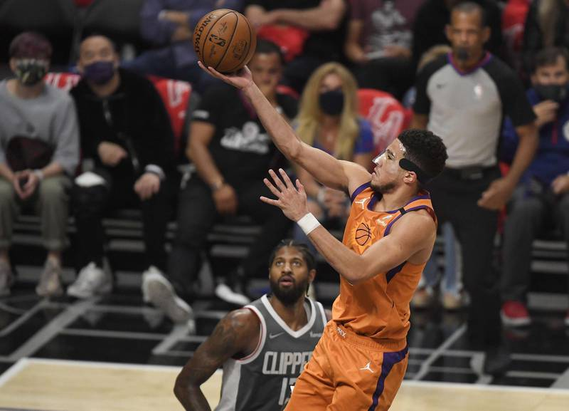 LOS ANGELES, CALIFORNIA - JUNE 26: Devin Booker #1 of the Phoenix Suns goes up for a shot against the LA Clippers during the second half in game four of the Western Conference Finals at Staples Center on June 26, 2021 in Los Angeles, California. NOTE TO USER: User expressly acknowledges and agrees that, by downloading and or using this photograph, User is consenting to the terms and conditions of the Getty Images License   Kevork Djansezian/Getty Images/AFP == FOR NEWSPAPERS, INTERNET, TELCOS & TELEVISION USE ONLY ==