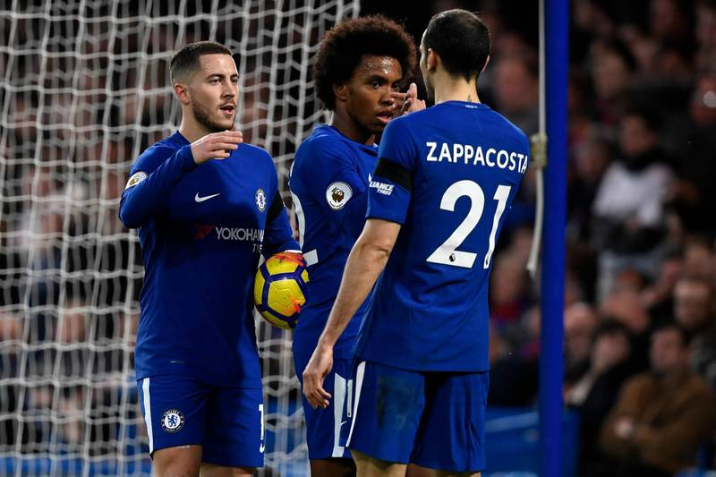 epa06594592 Chelsea's Eden Hazard (L), Willian (C) and Davide Zappacosta (R) celebrate after Crystal Palace's Martin Kelly scored an own goal during the English Premier League soccer match Chelsea vs Crystal Palace at Stamford Bridge, London, Britain, 10 March 2018.  EPA/WILL OLIVER EDITORIAL USE ONLY. No use with unauthorized audio, video, data, fixture lists, club/league logos or 'live' services. Online in-match use limited to 75 images, no video emulation. No use in betting, games or single club/league/player publications