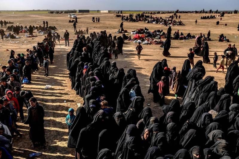 """TOPSHOT - Civilians evacuated from the Islamic State (IS) group's embattled holdout of Baghouz wait at a screening area held by the US-backed Kurdish-led Syrian Democratic Forces (SDF), in the eastern Syrian province of Deir Ezzor, on March 5, 2019. Kurdish-led forces launched a final assault Friday on the last pocket held by the Islamic State group in eastern Syria, their spokesman said. The """"operation to clear the last remaining pocket of ISIS has just started"""", Mustefa Bali, the spokesman of the US-backed Syrian Democratic Forces, said in a statement using an acronym for the jihadist group. - == QUALITY RESEND ==   == SEE """"1E94VL"""" FOR FIRST FILE ==  / AFP / Bulent KILIC / == QUALITY RESEND ==   == SEE """"1E94VL"""" FOR FIRST FILE =="""