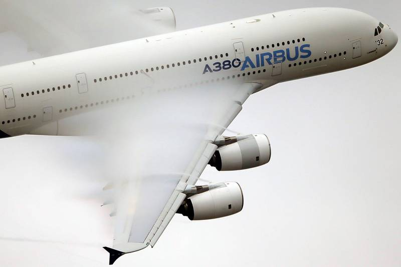 FILE - In this June 18 2015 file photo, vapour forms across the wings of an Airbus A380 as it performs a demonstration flight at the Paris Air Show, Le Bourget airport, north of Paris. A World Trade Organization panel ruled Tuesday, May 15, 2018 that the European Union continues to provide illegal subsidies to plane-maker Airbus, the latest in a string of tussles between the European manufacturer and U.S. rival Boeing. (AP Photo/Francois Mori, File)