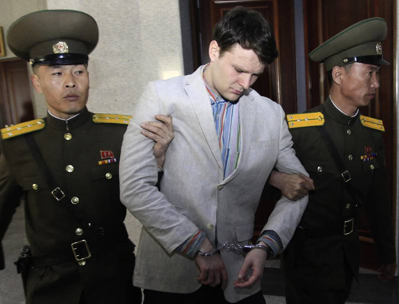 """FILE �������� In this March 16, 2016, file photo, American student Otto Warmbier, center, is escorted at the Supreme Court in Pyongyang, North Korea. Fred and Cindy Warmbier, the parents of a young Ohioan who was detained in North Korea for more than a year and died soon after being released, appeared on Fox News' """"Fox & Friends"""" morning TV show Tuesday, Sept. 26, 2017, saying their son was """"jerking violently,"""" howling, and """"staring blankly"""" when he returned home on a medical flight that arrived June 13 in Cincinnati. He died less than a week after returning at University of Cincinnati Medical Center. (AP Photo/Jon Chol Jin, File)"""