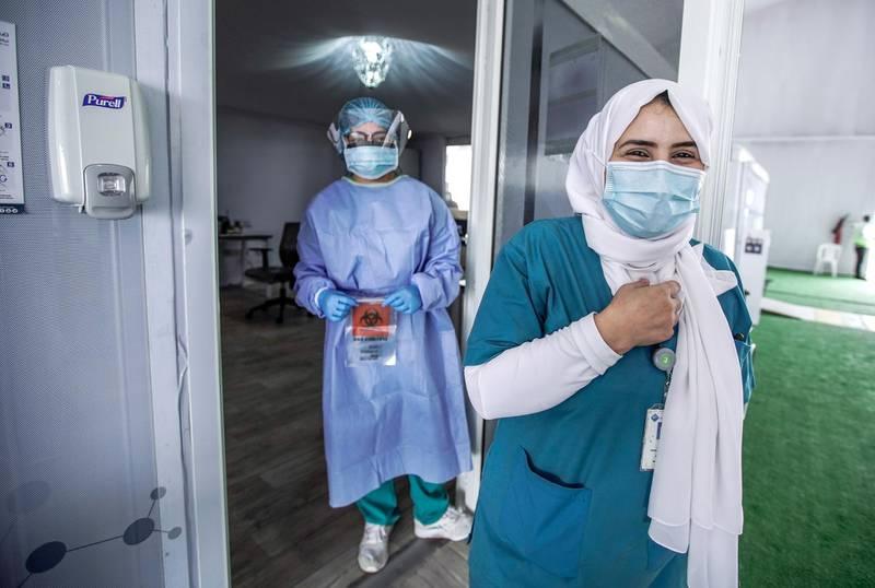 Dubai, United Arab Emirates, April 12, 2020.  The National Screening Center, Mina Rashed, Dubai.  Nurses smile for the camera.Victor Besa / The NationalSection:  NAReporter:  Nick Webster