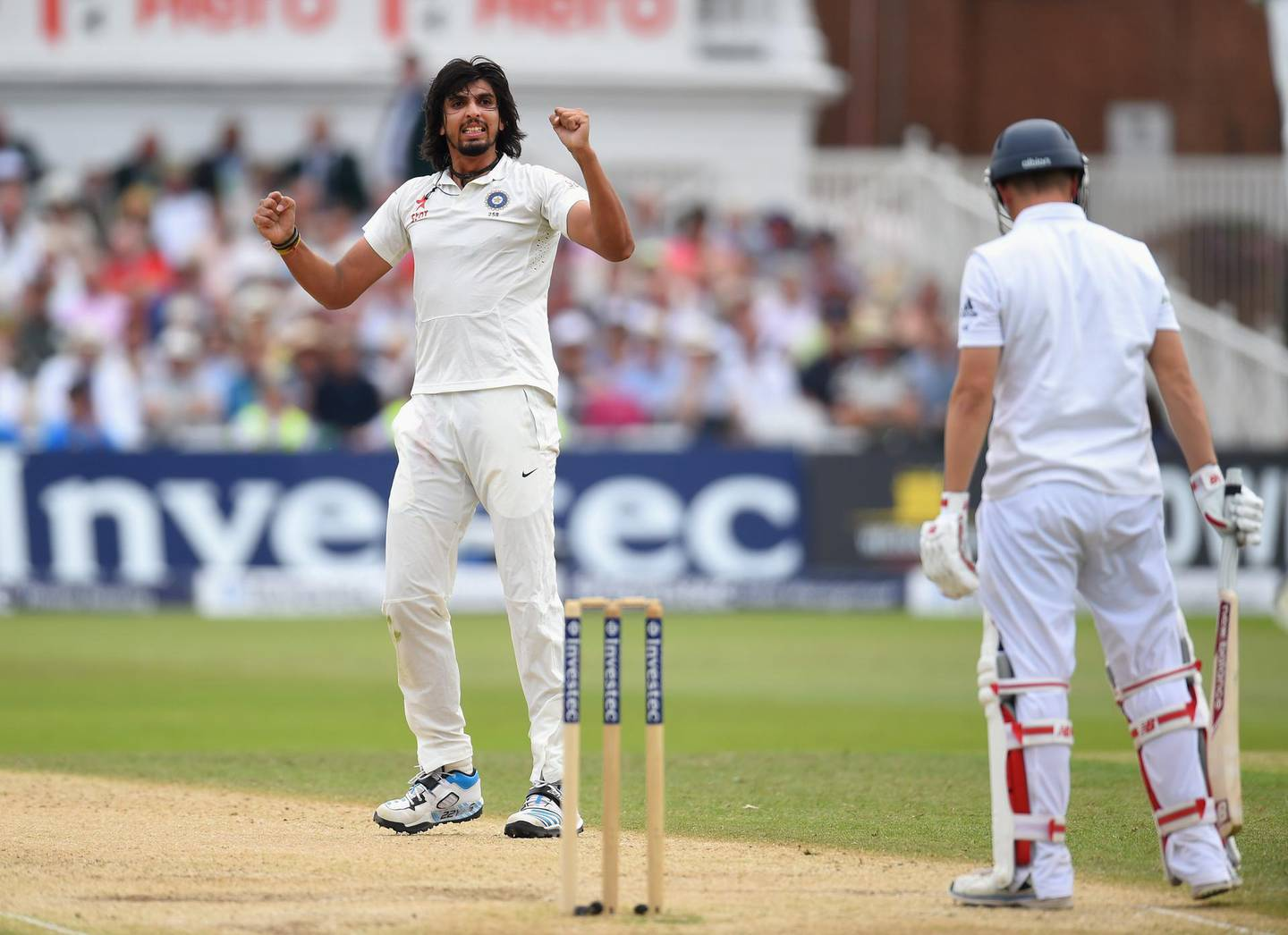 NOTTINGHAM, ENGLAND - JULY 11:  India bowler Ishant Sharma celebrates after dismissing England batsman Gary Ballance during day three of the 1st  Investec Test Match between England and India at  Trent Bridge on July 11, 2014 in Nottingham, England.  (Photo by Stu Forster/Getty Images)