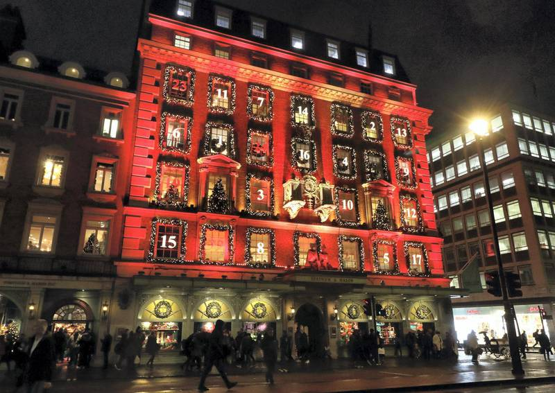 LONDON, UNITED KINGDOM - 2019/12/17: London's upmarket department store Fortnum & Mason in Piccadilly has been transformed into a giant advent calendar this Christmas.  Its iconic facade is bathed in red with its windows decorated and numbered like a traditional advent calendar. Its windowdisplays are also some of the best in the capital for the festive season. (Photo by Keith Mayhew/SOPA Images/LightRocket via Getty Images)