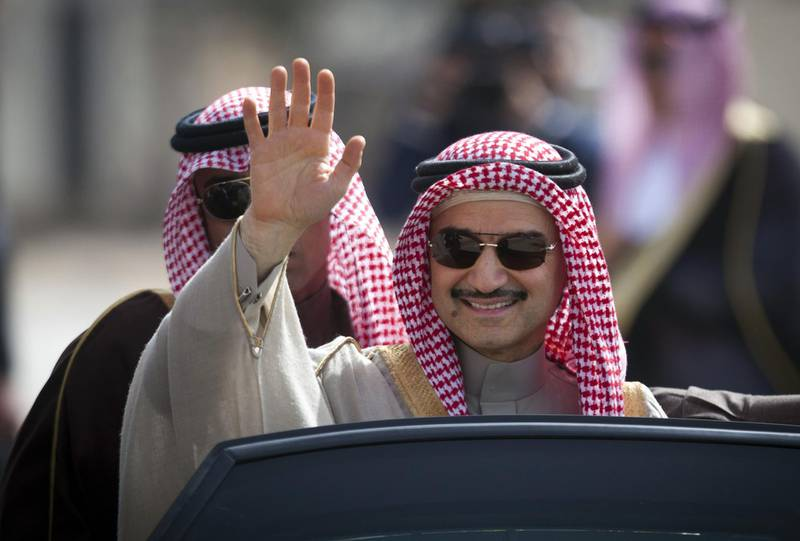 FILE - In this Feb. 4, 2014 file photo, Saudi billionaire Prince Alwaleed bin Talal, waves as he arrives at the headquarters of Palestinian President Mahmoud Abbas in the West Bank city of Ramallah. The unprecedented anti-corruption campaign has exposed a new hierarchy in the kingdom and brought into sharp focus just how little power even the wealthiest royals wield in the face of the country's young potentate-in-waiting, Crown Prince Mohammed bin Salman. (AP Photo/Majdi Mohammed, File)