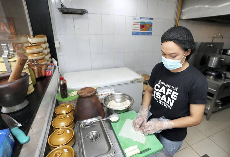 Dubai, United Arab Emirates - Reporter: N/A. News. Covid-19/Coronavirus. Chef New makes vegetable spring rolls with Covid-19 precautions. Saturday, October 10th, 2020. Dubai. Chris Whiteoak / The National