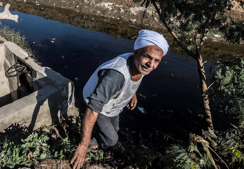 Egyptian farmer Mohamed Omar, 65, supplies his farmland with water from a canal, fed by the Nile river, in the village of Baharmis on the outskirts of Egypt's Giza province, northwest of the capital Cairo, on December 1, 2019. - Egypt has for years been suffering from a severe water crisis that is largely blamed on population growth. Mounting anxiety has gripped the already-strained farmers as the completion of Ethiopia's gigantic dam on the Blue Nile, a key tributary of the Nile, draws nearer. Egypt views the hydro-electric barrage as an existential threat that could severely reduce its water supply. But Ethiopia insists that Egypt's water share will not be affected. (Photo by Khaled DESOUKI / AFP)