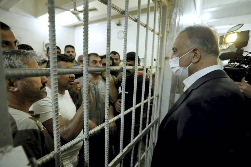 Iraqi Prime Minister Mustafa al-Kadhimi talks to prisoners during his visit in the central investigation prison in Al-Muthana airport in Baghdad, Iraq July 30, 2020. Iraqi Prime Minister Media Office/Handout via REUTERS ATTENTION EDITORS - THIS IMAGE WAS PROVIDED BY A THIRD PARTY.
