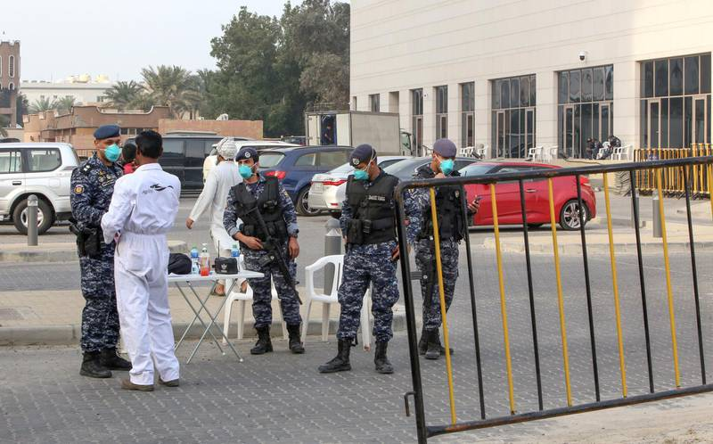 Members of Kuwait's national guard wearing safety masks keep watch outside a hotel in the capital where Kuwaitis returning from Iran are quarantined and tested for coronavirus COVID-19, on February 24, 2020. - Kuwait confirmed three cases who tested positive for coronavirus, a 53-year-old Kuwaiti man, a 61-year-old Saudi citizen, and a 21-year-old stateless Arab (Bidoon), after returning from Iran's holy city of Mashhad. (Photo by Yasser Al-Zayyat / AFP)