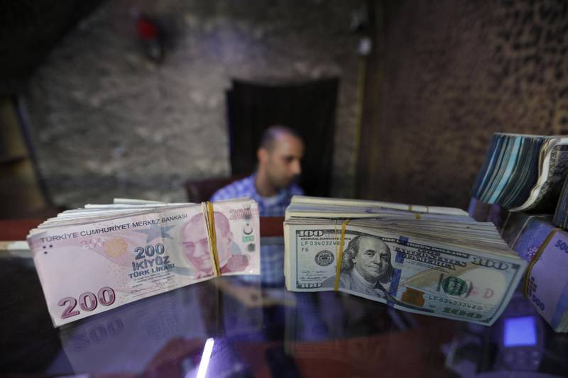 Banknotes of U.S. dollars and Turkish lira are seen in a currency exchange shop in the city of Azaz, Syria August 18, 2018. Picture taken August 18, 2018. REUTERS/Khalil Ashawi