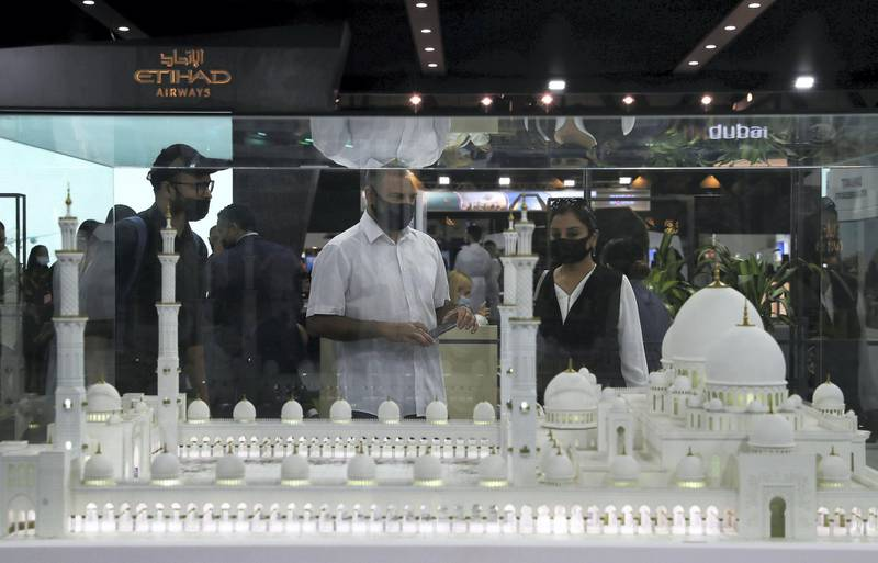 Visitors at the Abu Dhabi Stand looking at the model of Sheikh Zayed Grand Mosque at the Arabian Travel Market held at Dubai World Trade Centre in Dubai on May 16,2021. Pawan Singh / The National. Story by Deena