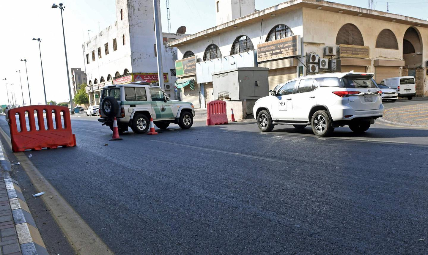 Saudi police close a street leading to a non-Muslim cemetery in the Saudi city of Jeddah where a bomb struck a World War I commemoration attended by European diplomats on November 11, 2020 leaving several people wounded amid Muslim anger over French cartoons.   The attack is the second assault in the kingdom in less than a month, as French President Emmanuel Macron has sought to assuage anger across Muslim nations over satirical cartoons of the Prophet Mohammed.  / AFP / -