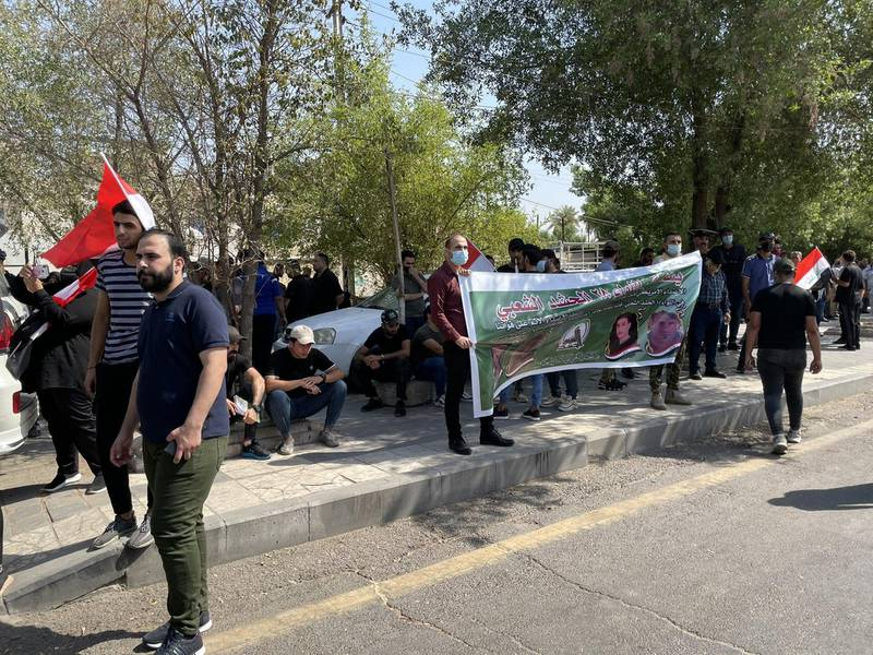 PMF fighters and supporters are preparing for the funeral procession near Baghdad's fortified Green Zone for four fighters killed in Monday's US air strikes along Iraq-Syria border. Sinan S. Mahmoud / The National