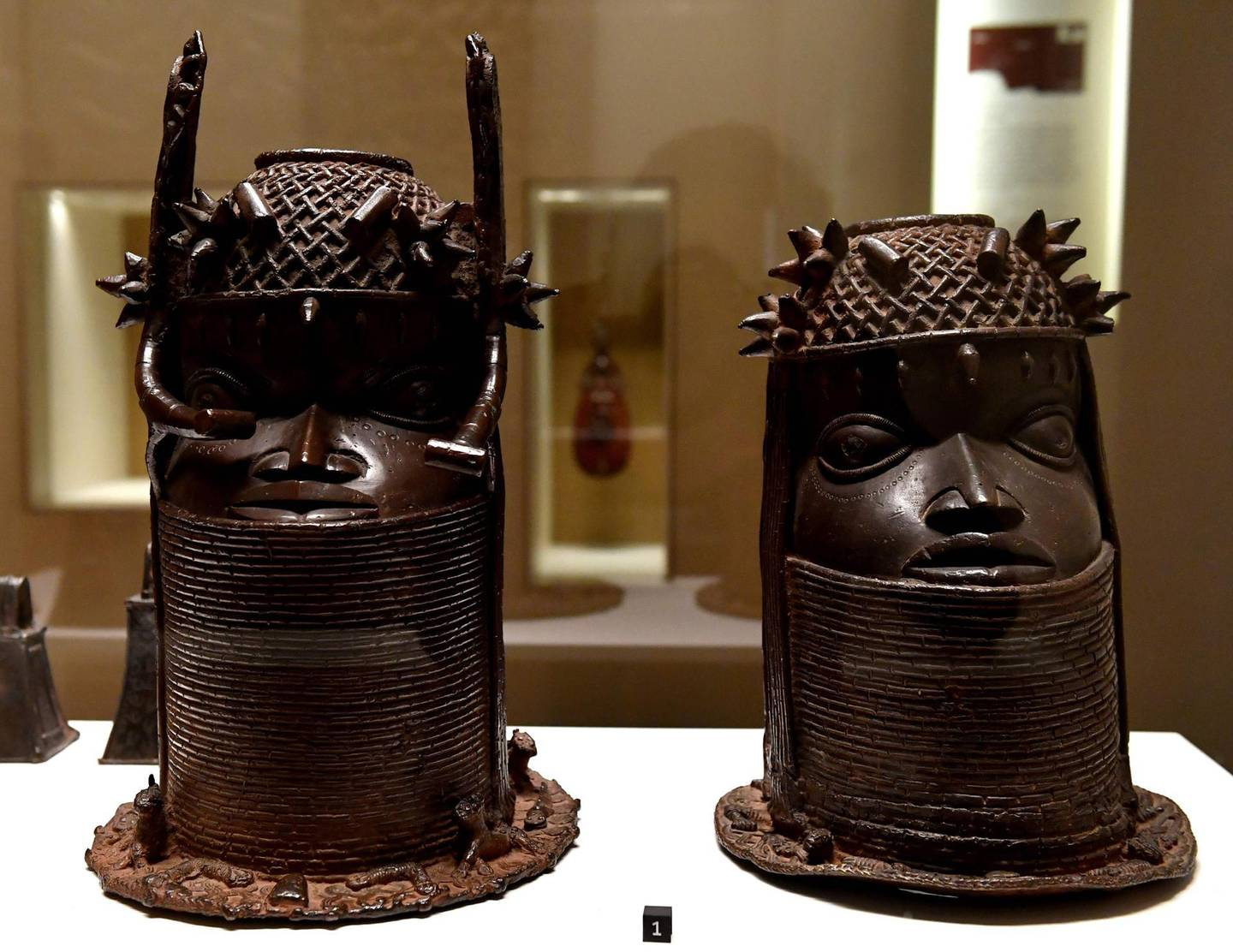Heads of a Royal ancestor, arts of the Kingdom of Benin of the end of the 18th century are on display on June 18, 2018 at the Quai Branly Museum-Jacques Chirac in Paris. Benin is demanding restitution of its national treasures that had been taken from the former French colony Dahomey (current Benin) to France and currently are on display at Quai Branly, a museum featuring the indigenous art and cultures of Africa. / AFP / GERARD JULIEN