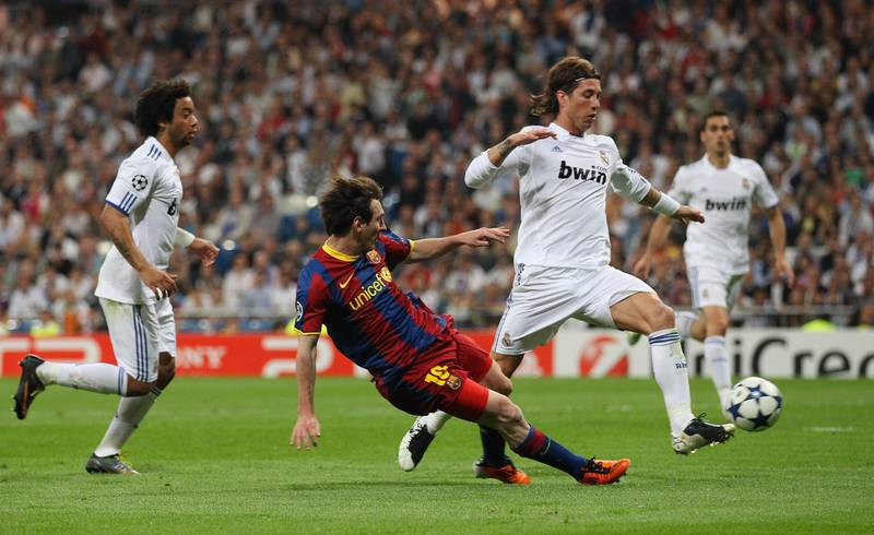 MADRID, SPAIN - APRIL 27:  Lionel Messi of Barcelona scores his second goal during the UEFA Champions League Semi Final first leg match between Real Madrid and Barcelona at Estadio Santiago Bernabeu on April 27, 2011 in Madrid, Spain.  (Photo by Alex Livesey/Getty Images)