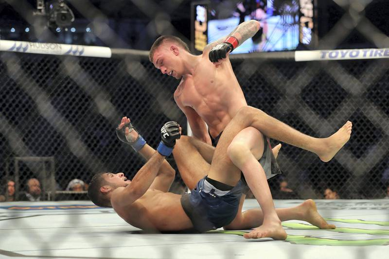 Abu Dhabi, United Arab Emirates - September 07, 2019: Lightweight bout between Fares Ziam (blue shorts) and Don Madge in the Early Prelims at UFC 242. Saturday the 7th of September 2019. Yas Island, Abu Dhabi. Chris Whiteoak / The National