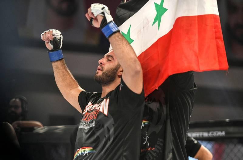 Abu Dhabi, United Arab Emirates - Tarek Suleiman from Syria wins the light heavy-weight round against Oli Thompson from Great Britain at the UAE Warriors MMA event at the Mubadala Arena, Zayed Sports City. Khushnum Bhandari for The National