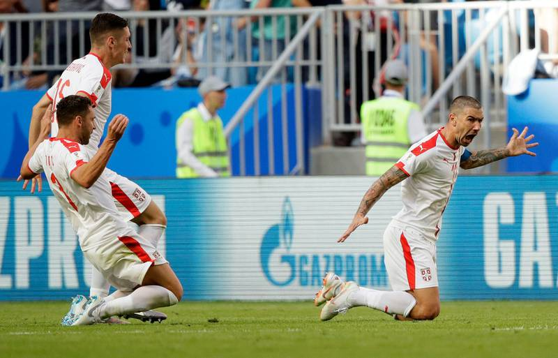 Serbia's Aleksandar Kolarov, right, celebrates with teammates scoring the opening goal during the group E match between Costa Rica and Serbia at the 2018 soccer World Cup in the Samara Arena in Samara, Russia, Sunday, June 17, 2018. (AP Photo/Mark Baker)