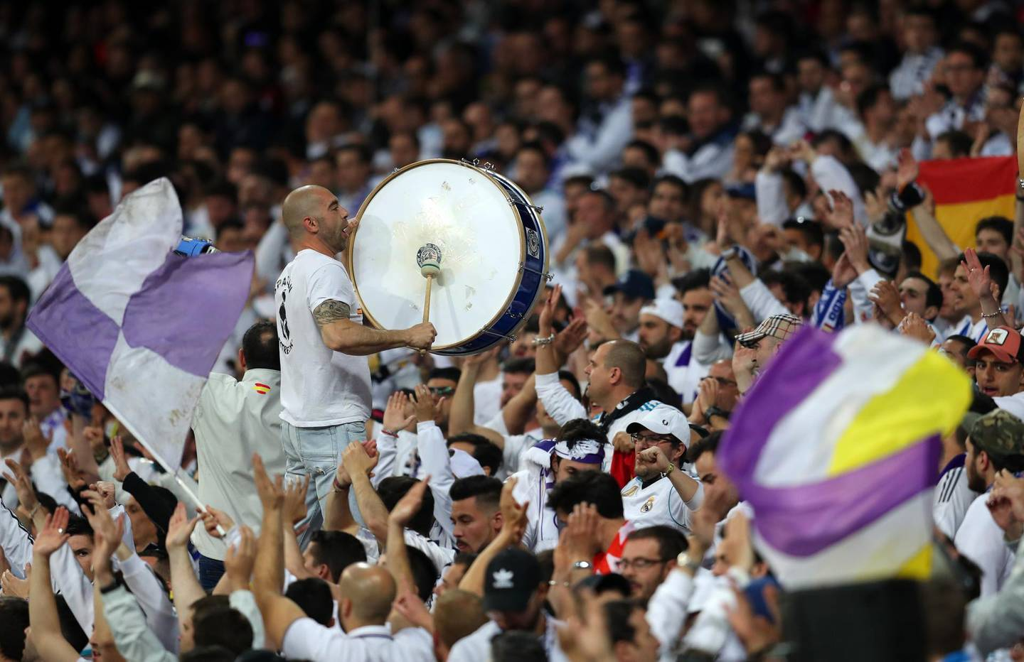 MADRID, SPAIN - MAY 01: Fans of Real Madrid with a drum during the UEFA Champions League Semi Final Second Leg match between Real Madrid and Bayern Muenchen at the Bernabeu on May 1, 2018 in Madrid, Spain. (Photo by Catherine Ivill/Getty Images)