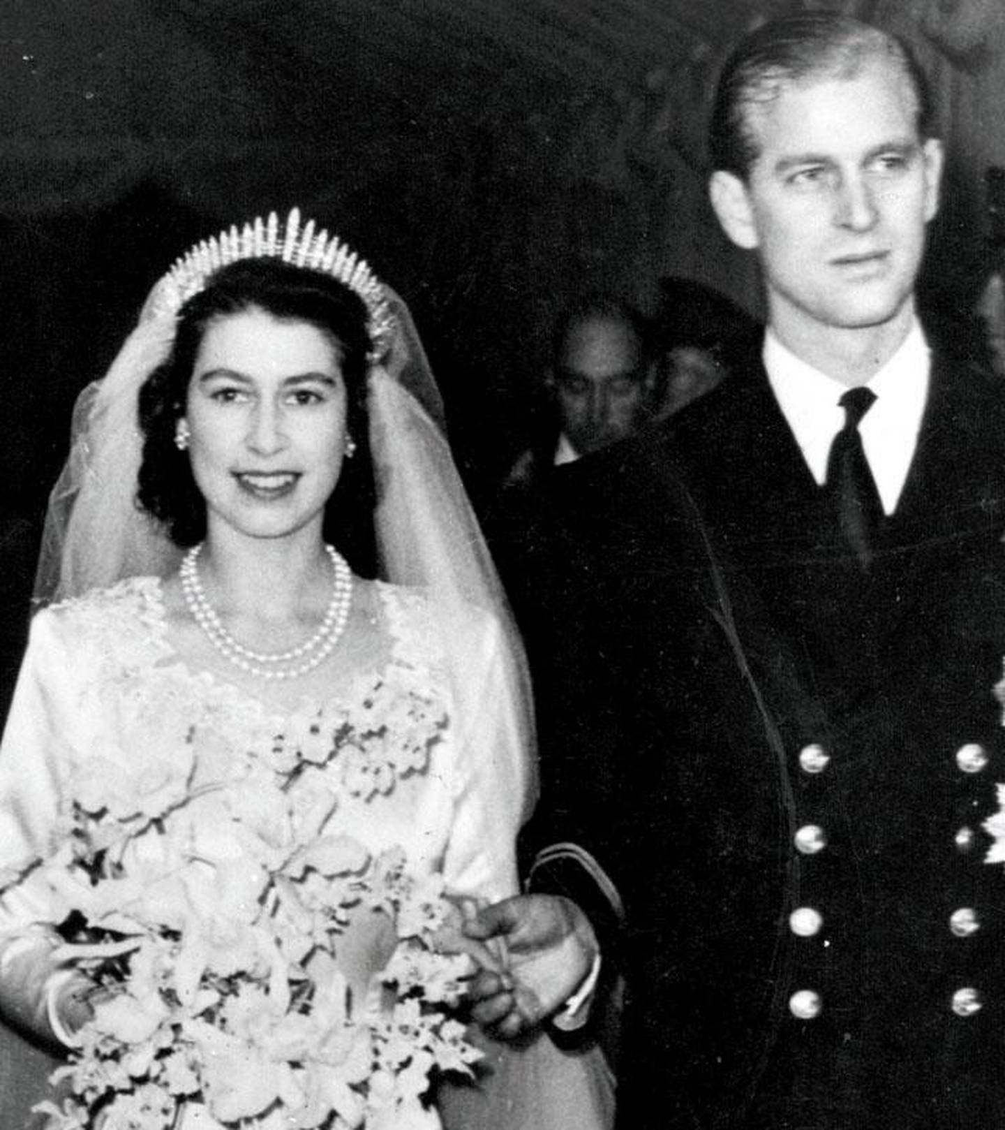 Queen Elizabeth II, as Princess Elizabeth, and her husband the Duke of Edinburgh, styled Prince Philip in 1957, on their wedding day. She became queen on her father King George VI's death in 1952.   (Photo by Hulton Archive/Getty Images)