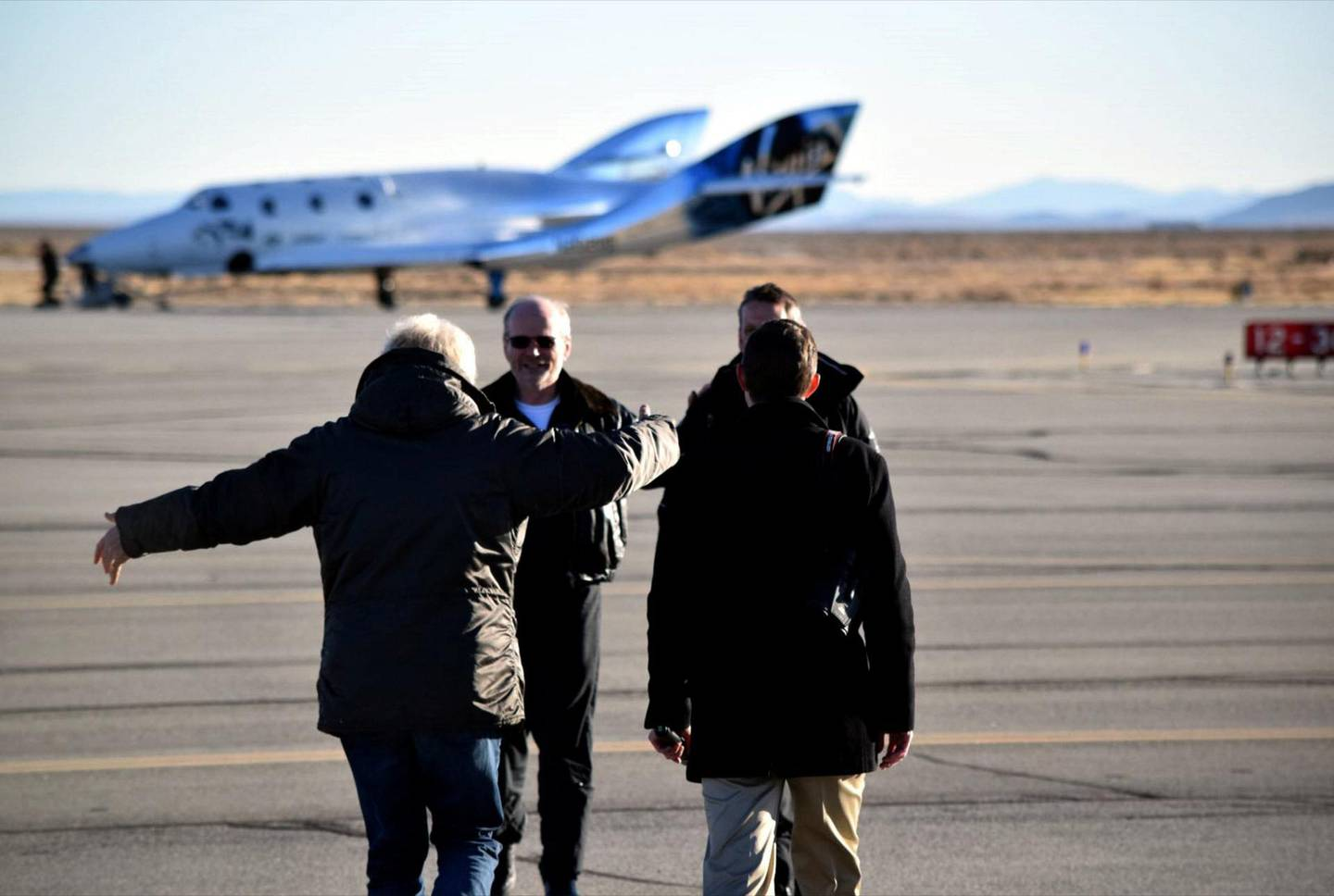 Sir Richard Branson and George Whitesides congratulate Chief Pilot Dave Mackay and Test Pilot Mark Stucky after a successful first glide flight of Virgin Spaceship Unity (VSS Unity) in Mojave Desert on 3rd December 2016.