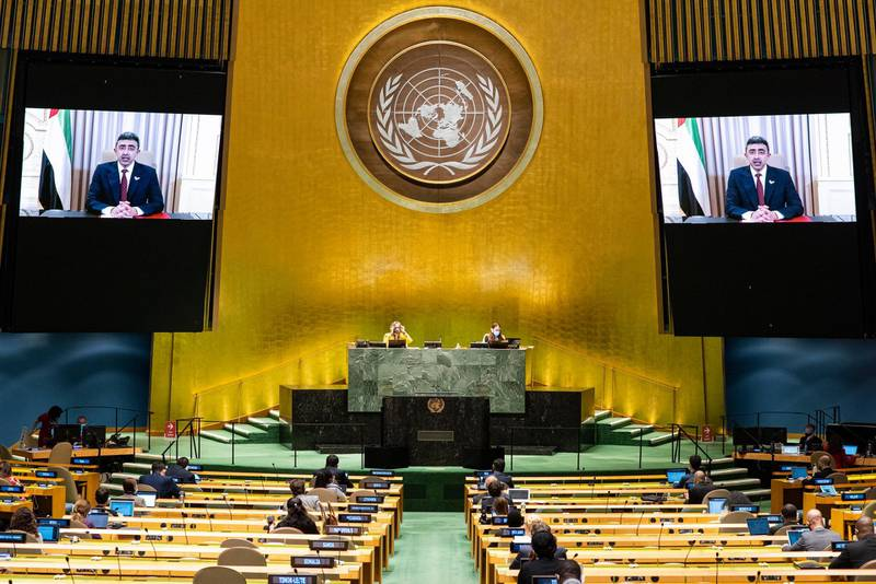 """This UN handout photo shows Sheikh Abdullah Bin Zayed Al Nahyan (on screens), Minister for Foreign Affairs and International Cooperation of the United Arab Emirates, as he virtually addresses the general debate of the 75th session of the United Nations General Assembly, on September 29, 2020, in New York. (Photo by Rick BAJORNAS / UNITED NATIONS / AFP) / RESTRICTED TO EDITORIAL USE - MANDATORY CREDIT """"AFP PHOTO / UNITED NATIONS /RICK BAJORNAS/HANDOUT"""" - NO MARKETING - NO ADVERTISING CAMPAIGNS - DISTRIBUTED AS A SERVICE TO CLIENTS"""