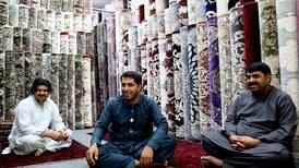 The social media star of Abu Dhabi's carpet souq