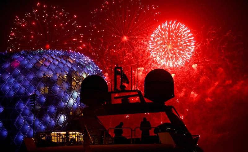 epaselect epa06812267 People are silhouetted on the flybridge of a yacht as fireworks illuminates the sky over the Yas Viceroy luxury hotel on the first day of the Muslim holiday of Eid Al-Fitr at the Marina on Yas Island, Abu Dhabi, United Arab Emirates, late 15 June 2018 (issued 16 June 2018). Muslims around the world are celebrating Eid al-Fitr, the three day festival marking the end of the Muslim holy month of Ramadan, it will be observed on 15th or 16th of June depending on the lunar calendar. Eid al-Fitr is one of the two major holidays in Islam.  EPA/ALI HAIDER